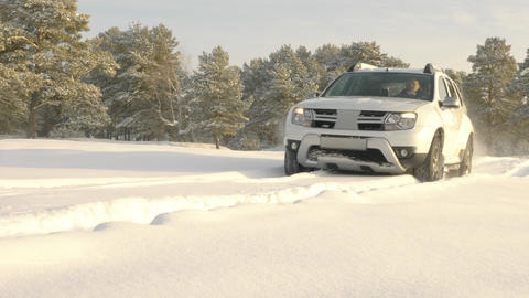 White SUV driving winter off road Live Action