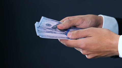 Businessman hands counting dollars in cash, shadow deals, money close-up Live Action