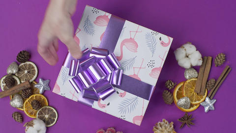 Gluing the bow to the present box, wrapping the present, parcel decoration, box Footage