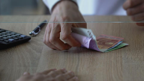 Bank employee counting exchange rate and changing clients euro for dollars Live Action