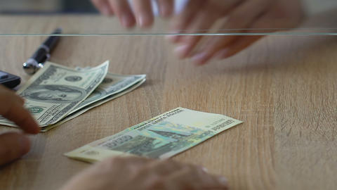 Man exchanging dollars for russian rubles in bank, foreign currency market Live Action