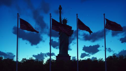 The American flags flutters in the wind on a sunrise against the blue sky and Fotografía