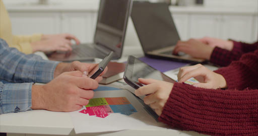Human hands networking with digital devices at desk Footage