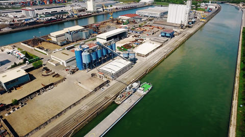 4K Aerial over harbor industry and river in the background at beautiful sunshine Footage