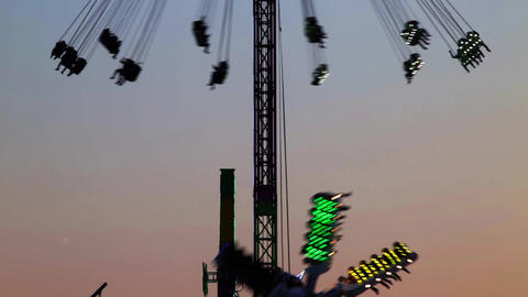 Fairground attractions at sunset Archivo