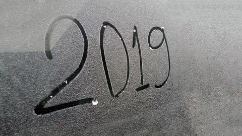 digits 2019 written on the window with snow background,happy new year 2019 Fotografía