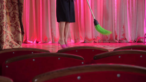 Woman cleans the broom on the stage after the concert Footage