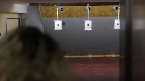 Girl Shoots A Target Footage