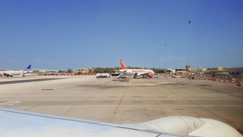 Malta International Airport MLA tarmac view with grounded airplanes GIF