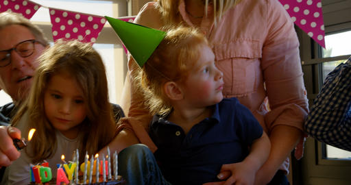 Family celebrating birthday party in living room 4k Live Action