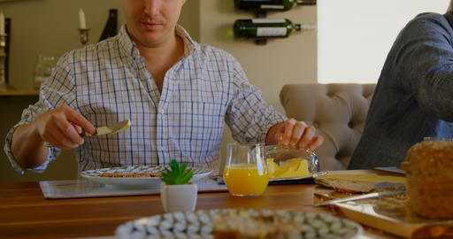 Family having food on dining table 4k Live Action