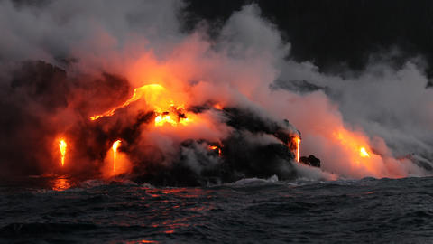 Lava flowing into the ocean from volcano lava eruption on Big Island Hawaii Footage