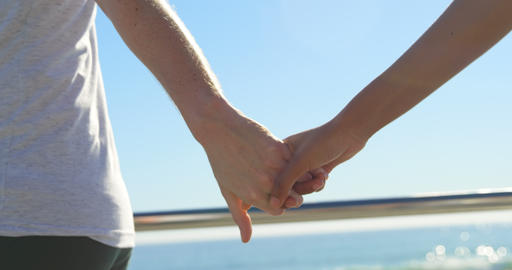 Close-up of couple running hand in hand on the promenade 4k Live Action