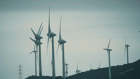 MANILVA, SPAIN - SEPTEMBER 27, 2018. Wind generators producing sustainable GIF