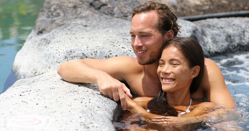 Romantic couple relaxing together romantic in hot tub... Stock Video Footage