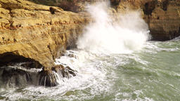 Powerful waves splashing at the cliffs, slow mo Footage