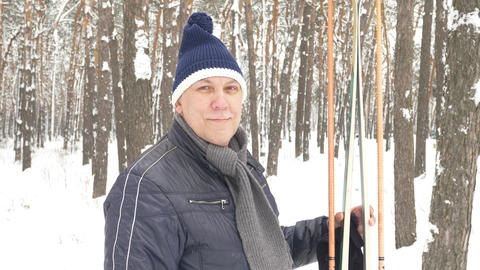 Portrait of senior in winter on snow with skis 영상물