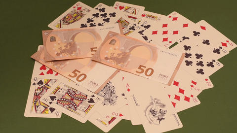 Playing cards and money Stock Video Footage