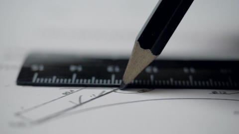 closeup engineer draws straight line with pencil and ruler GIF