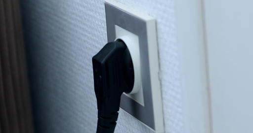 Plugging Different Power Plugs Into Wall Outlet Stock Video Footage