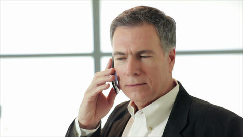 businessman on cell phone Live Action