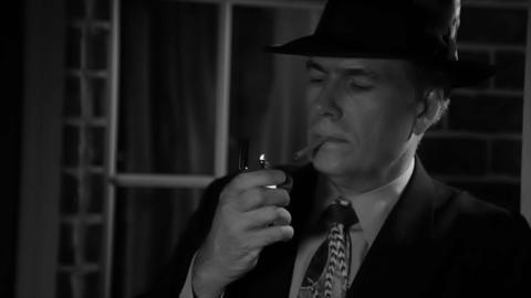 noir man smoking outdoors Footage