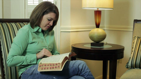 woman reading from the bible Footage