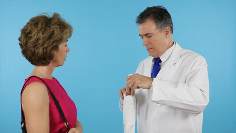 pharmacist gives prescription to woman Live Action