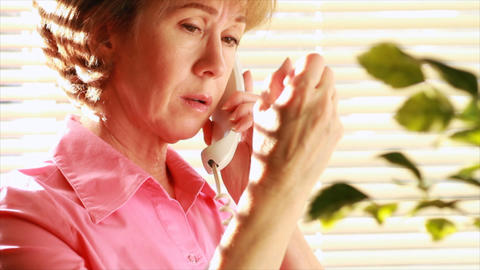 woman with arthritic hand phone call Live Action