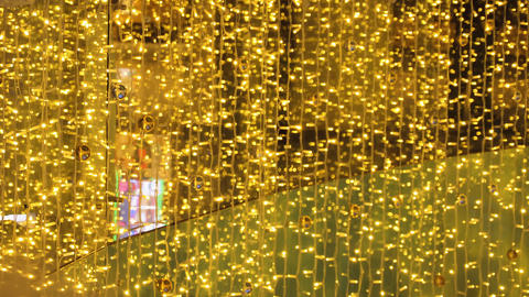 Christmas background with twinkling lights garland Archivo