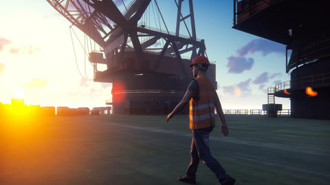 Oil worker walks on an oil platform at sunrise. Realistic cinematic animation Animation