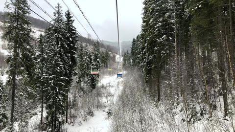 View from the chair to the chair lift at a ski resort in winter 영상물