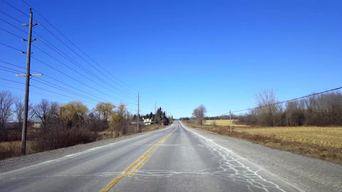 Driving Rural Road During Day. Driver Point of View POV Countryside Street in Live Action