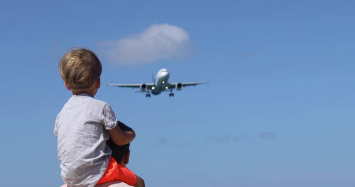 Father and son watching the landing plane 영상물