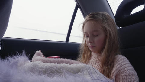 Young girl using smartphone in the car Footage