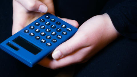 girl holds a solar calculator and accounts, footage suitable for sensitizing 영상물