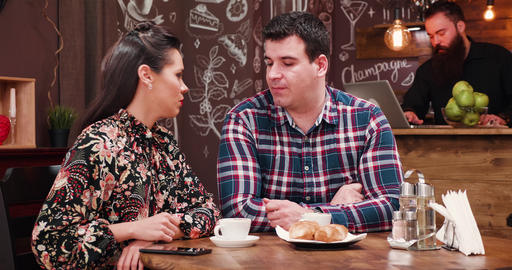 Couple on a date in stylish coffee shop pub restaurant drinking coffee and GIF