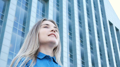 Low-angle portrait of a pretty girl with beautiful blue... Stock Video Footage