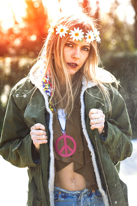 Girl hippie revolutionary 1970 style. Picture ruined simulation フォト