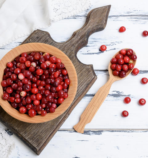 red berries of ripe lingonberries in a wooden bowl Photo