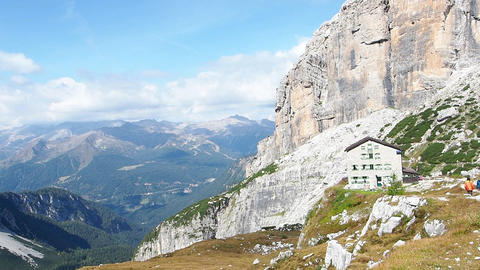 Landscape of Dolomites Mountains in Italy and mountain chalet Live Action