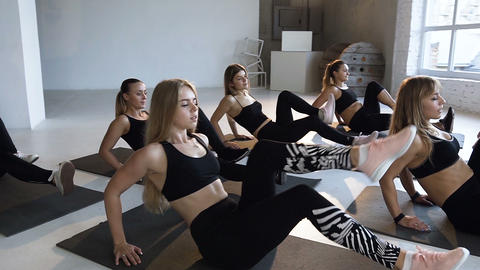 Group of young athletes women with instructor performs fitness aerobics on the 영상물