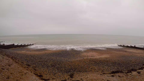 White waves are rolled on stony coast of Dover 영상물