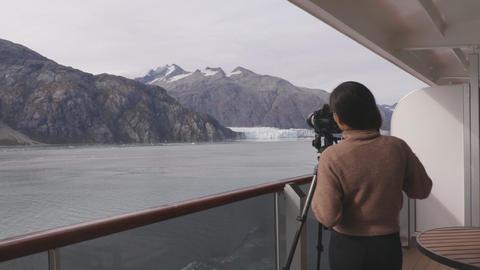 Photographer tourist in Alaska taking photos of glacier national park 영상물