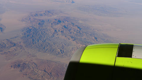 Aerial view on mountains through window of aircraft 영상물