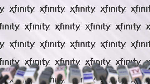 XFINITY company press conference, press wall with logo and mics, conceptual Footage