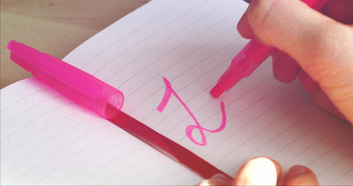 Woman Hand Writes On The Notebook Word LOVE GIF