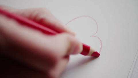Hand drawing heart contour by red pencil for Valentine's day Footage