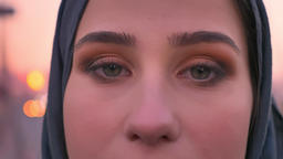 Closeup portrait of young beautiful muslim female gray eyes looking straight at Footage