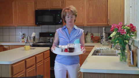 woman with tray in kitchen Footage